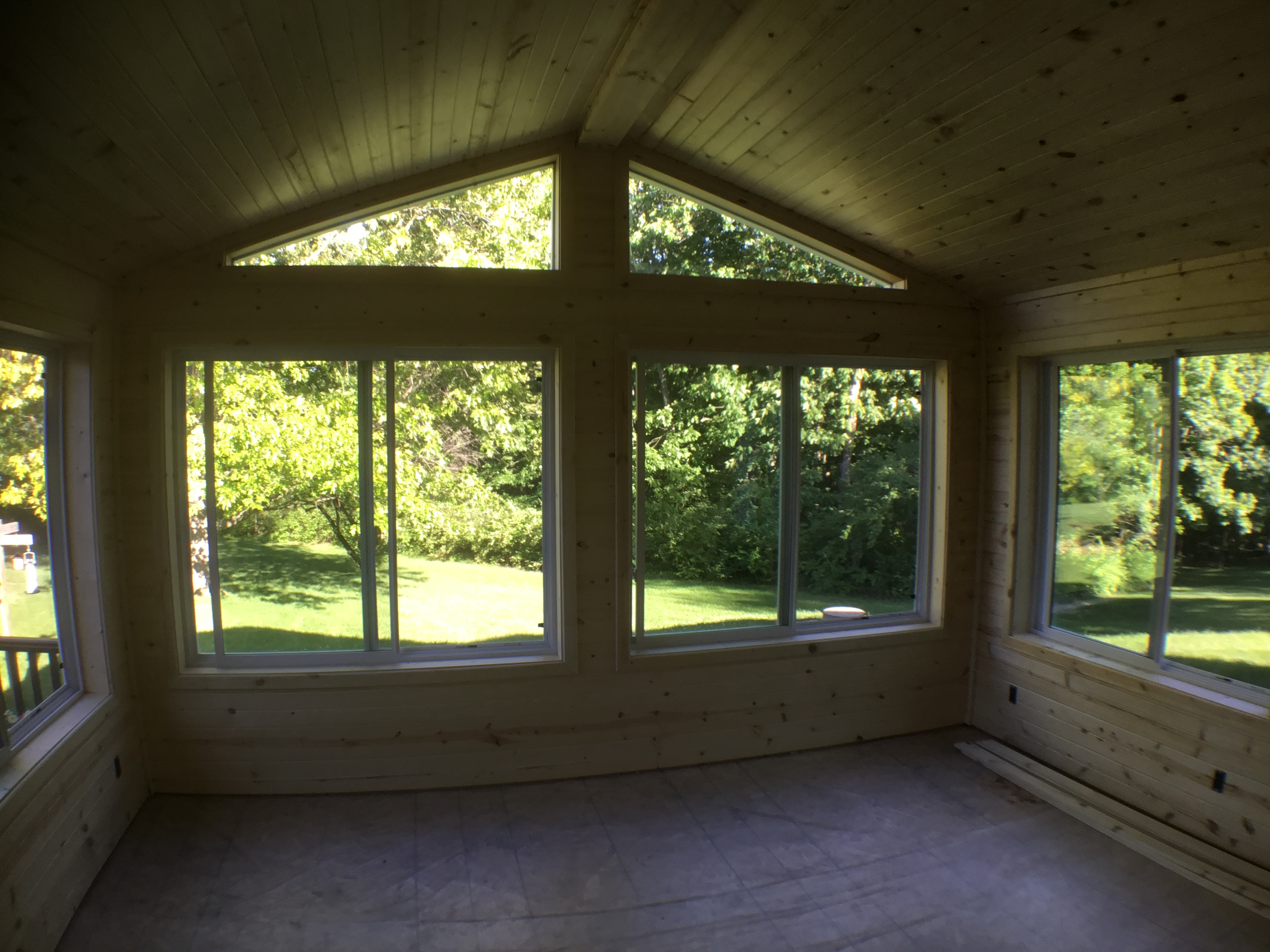 Inside Sunroom knotty pine