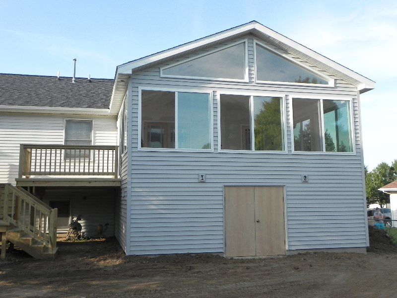 enclosed deck with shed to the backyard