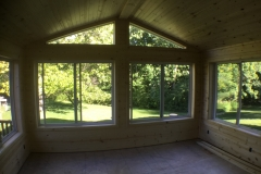 Inside Sunroom knotty pine